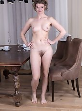 Philippa strips nude by her dining room table
